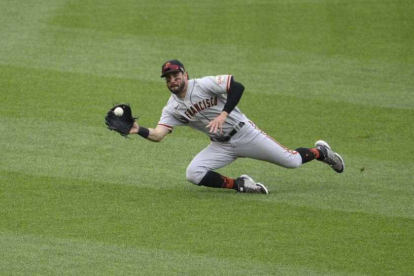 San Francisco Giants left fielder Mike Tauchman makes a catch on a line drive by Washington Nationals' Trea Turner for an out during the eighth inning of a baseball game, Sunday, June 13, 2021, in Washington. (AP Photo/Nick Wass)