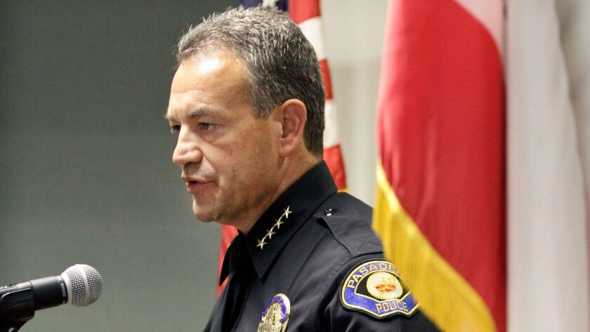 The Pasadena police officer whose home was searched for weapons recently served as an adjutant to Police Chief Phillip L. Sanchez, above.