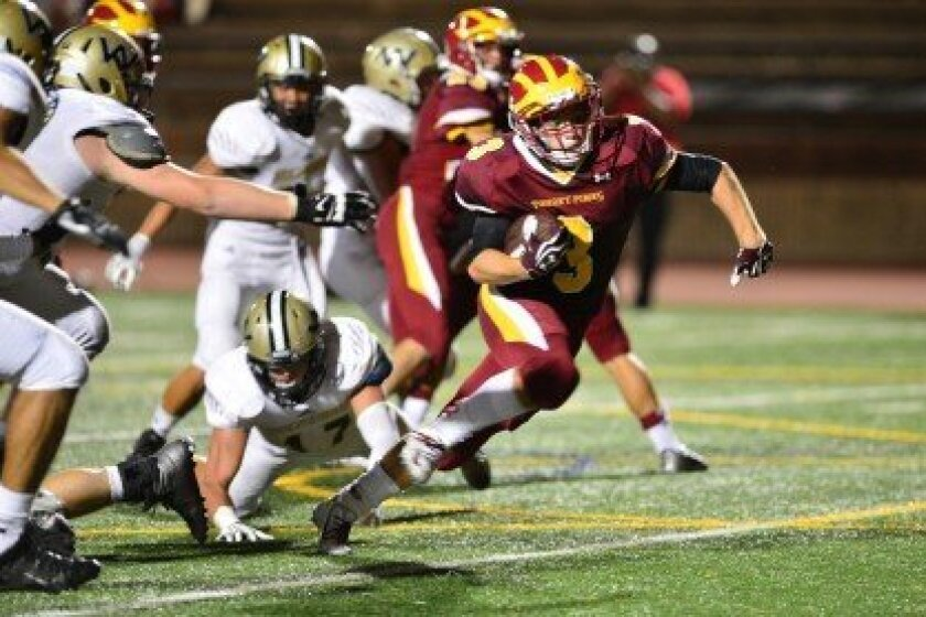 "The Torrey Pines High School Varsity Football Team got its first win of the season on Sept. 19 with a convincing 42-14 victory over Westview High in front of a full crowd. The Cardinal Chaos organized a ""beach-out,"" with student fans wearing beachy get-ups. (Above) Jack Hoeprich rushes toward a sco"