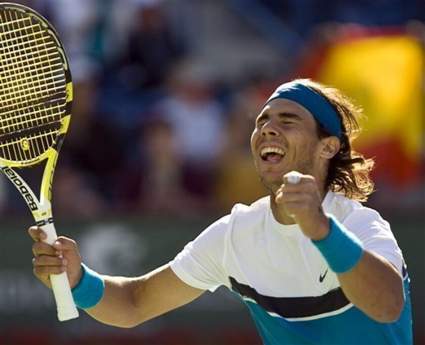 Rafael Nadal, of Spain, celebrates winning the men's final against Andy Murray at the BNP Paribas Open tennis tournament in Indian Wells, Calif., Sunday, March 22, 2009. Nadal won 6-1, 6-2. (AP Photo/Mark Avery)