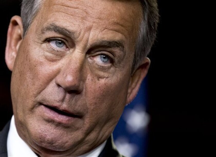 """FILE - This Nov. 29, 2012 file photo shows House Speaker John Boehner of Ohio speaking to reporters on Capitol Hill in Washington. House Republicans negotiating with President Barack Obama on avoiding the so-called fiscal cliff are proposing to increase the eligibility age for Medicare and to lower cost-of-living hikes in Social Security benefits. Boehner said the GOP proposal is a """"credible plan"""" for Obama and that he hopes the administration would """"respond in a timely and responsible way."""" (AP Photo/J. Scott Applewhite, File)"""