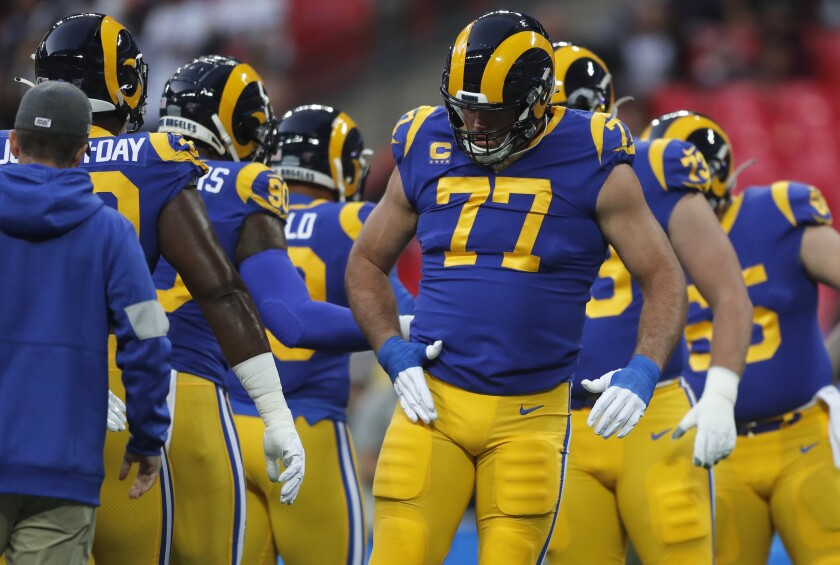 Rams offensive tackle Andrew Whitworth (77) warms up with teammates before playing against the Bengals, his former team, for the first time.
