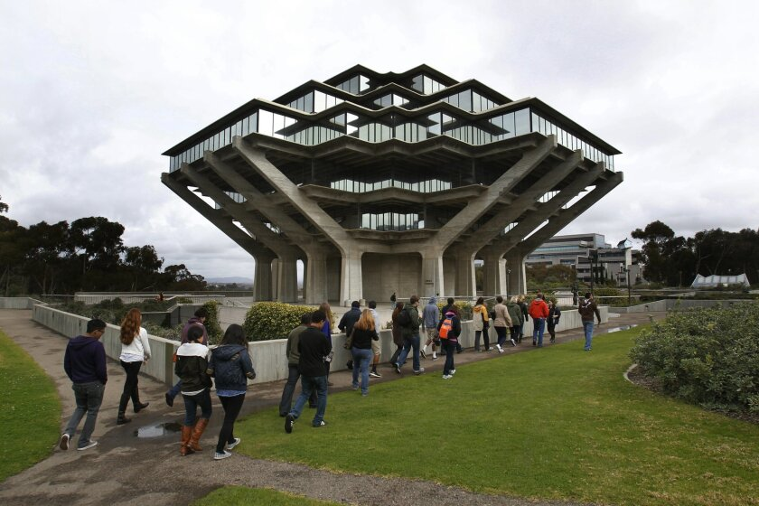 Students hoping to attend UC San Diego took a recent campus tour near the campus' iconic Geisel Library.