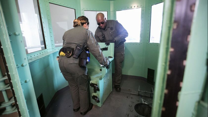 A chair is removed from the death penalty chamber at San Quentin State Prison in San Quentin, Calif. on March 13.