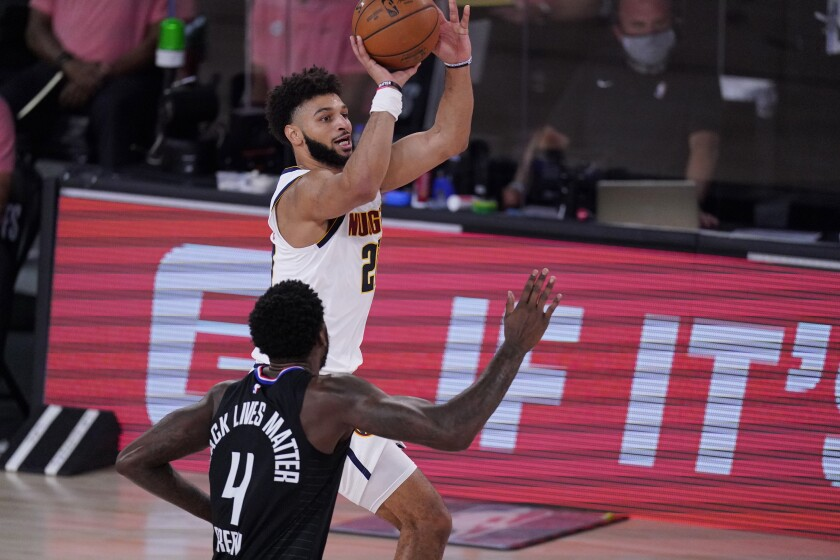 Denver Nuggets guard Jamal Murray shoots past Clippers forward JaMychal Green.