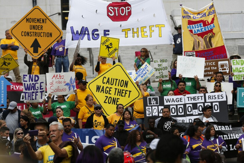 Low-wage garment, car wash, restaurant and other workers outside Los Angeles City Hall in 2015 urged city leaders to form an anti-wage theft bureau and adopt strong enforcement measures.