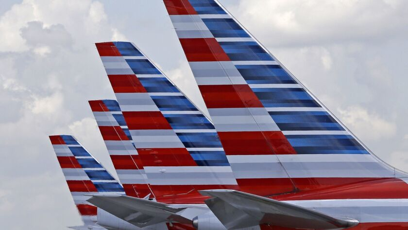 The NAACP has lifted a travel advisory it issued against American Airlines last fall after a series of incidents. Above, American planes at Miami International Airport.
