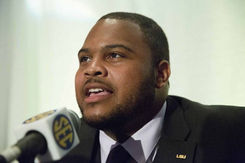 FILE - In this July 16, 2015, file photo, LSU offensive lineman Vadal Alexander speaks to the media at the Southeastern Conference NCAA college football media days, in Hoover, Ala. Some of the Southeastern Conference's best players this season are Vadal Alexander, Ryan Kelly and Laremy Tunsil. If o