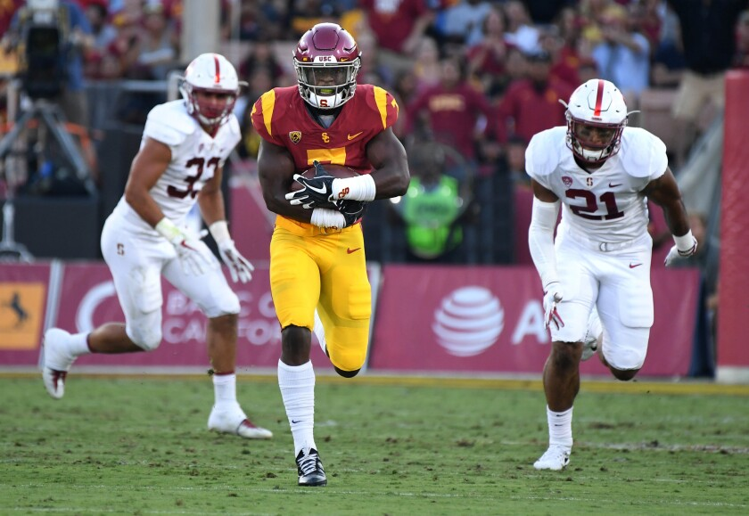 USC running back Stephen Carr breaks free for a huge gain against Stanford during a game at the Coliseum last season. USC won 42-24.