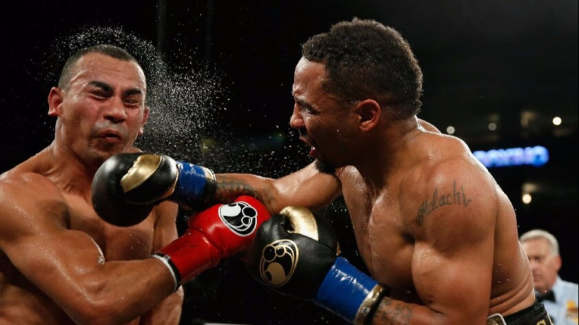 Andre Ward hits Alexander Brand with a right hand during their WBO Intercontinental light-heavyweight title bout on Aug. 6.