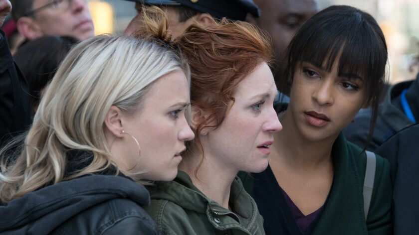 "Emily Osment, left, Brittany Snow and Megalyn Echikunwoke in ""Almost Family"" on Fox."