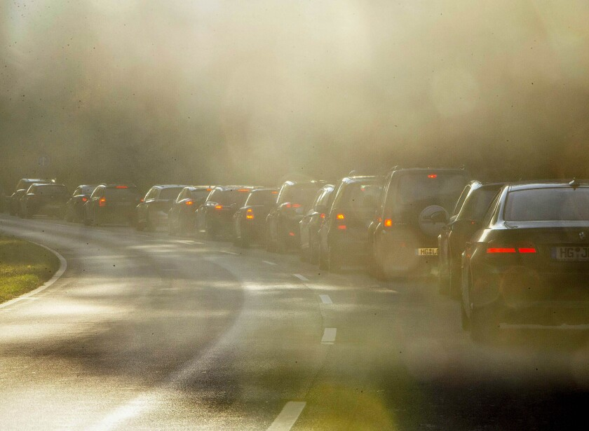 """FILE-In this Oct. 31, 2018 file photo people queue in a traffic jam when commuting to Frankfurt, Germany. The European Union's top court ruled Thursday that Germany """"systematically and persistently"""" exceeded limits on nitrogen dioxide, a harmful gas produced by diesel engines, in many regions between 2010 and 2016.(AP Photo/Michael Probst, file)"""