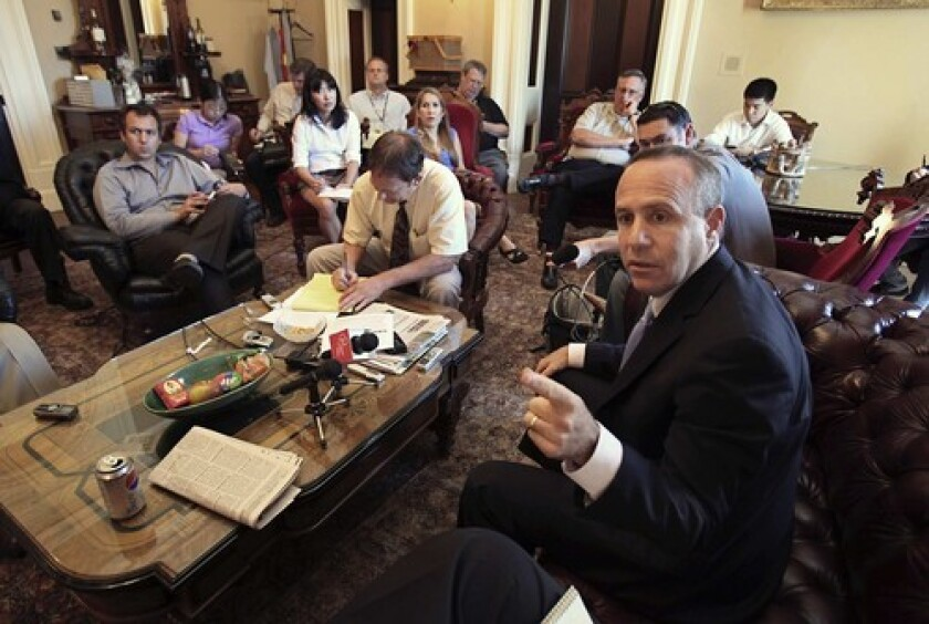 State Senate President Darrell Steinberg discusses with reporters the provisions of the proposed state budget deal.