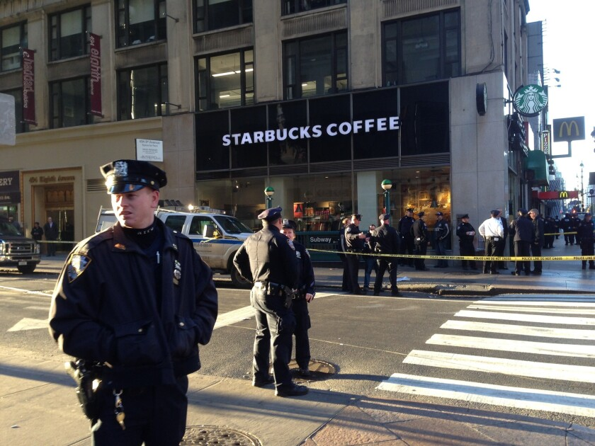 New York Police Department officers investigate a shooting near Penn Station.