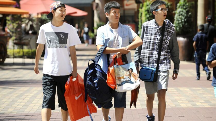 LOS ANGELES-CA-AUGUST 12, 2015: Chinese tourists shop at the Citadel Outlets in Commerce on Wednesda