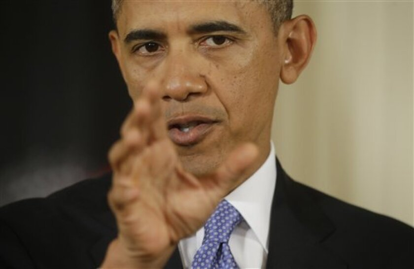 President Barack Obama gestures as he answers a question during a joint news conference with Afghan President Hamid Karzai in the East Room of the White House in Washington, Friday, Jan. 11, 2013. (AP Photo/Pablo Martinez Monsivais)