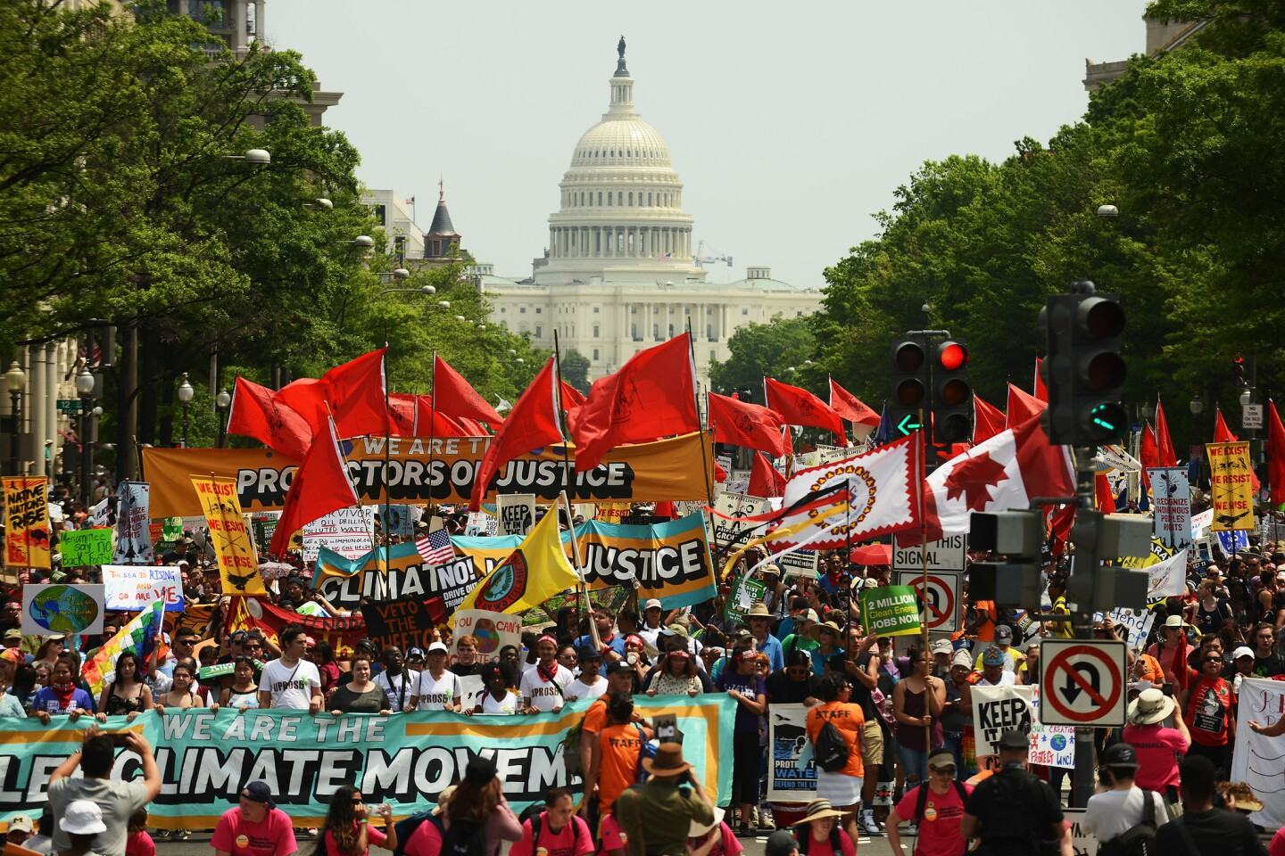 People march from the U.S. Capitol to the White House for the People's Climate Movement to protest President Donald Trump's enviromental policies on April 29, 2017 in Washington, D.C.