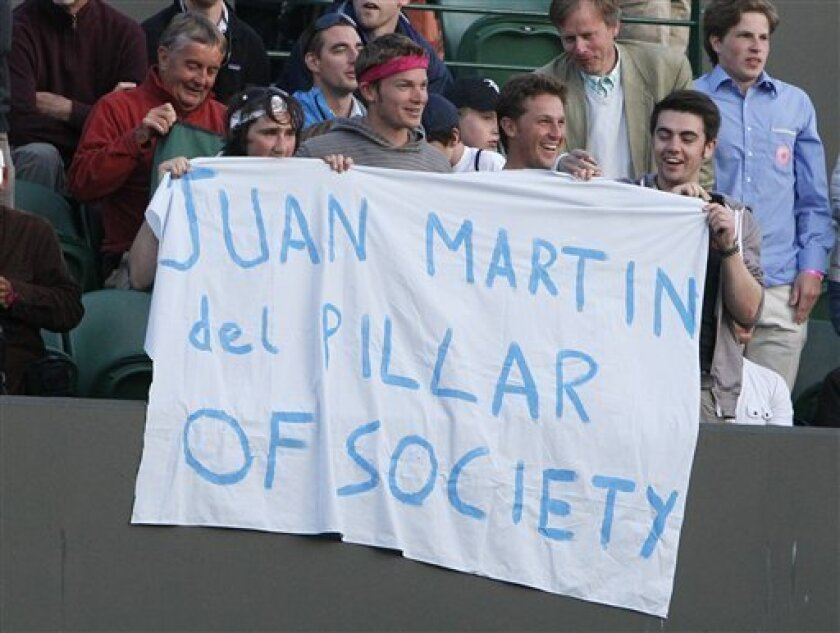 Fans of Argentina's Juan Martin Del Potro hold up a banner during his match against Olivier Rochus of Belgium at the All England Lawn Tennis Championships at Wimbledon, Wednesday, June 22, 2011. (AP Photo/Alastair Grant)
