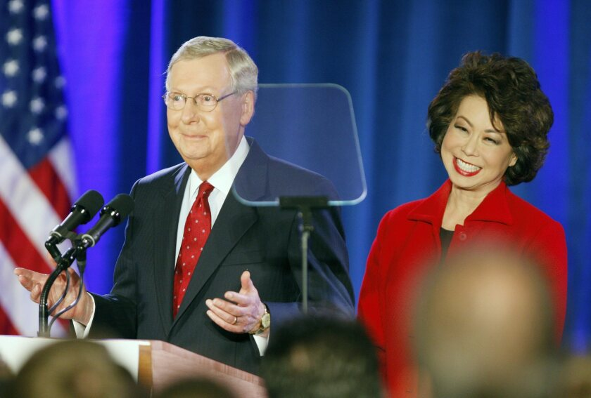 Senator Mitch McConnell (R-Ky.), speaks to supporters with his wife Elaine Chao during his victory celebration.