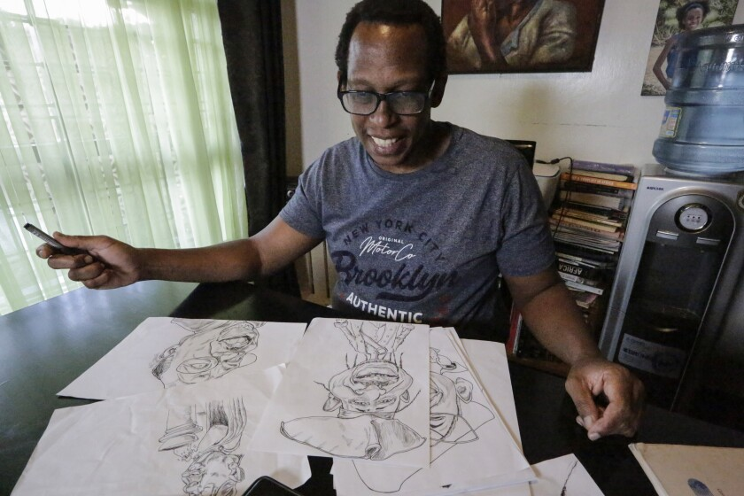Kenyan cartoonist and commentator Patrick Gathara works on drawing cartoons at his house in Nairobi, Kenya, Thursday, Nov. 5, 2020. As the United States twists itself into knots over its most contentious vote in decades, Gathara has spun out a widely read alternate commentary on Twitter, drawing freely from cliches that long have been aimed at elections in Africa. (AP Photo/Khalil Senosi)