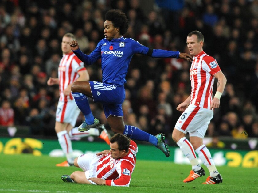 Chelsea's Willian avoids a tackle by jumping over Stoke's Xherdan Shaqiri during the English Premier League soccer match between Stoke City and Chelsea at the Britannia Stadium, Stoke on Trent, England, Saturday, Nov. 7, 2015. (AP Photo/Rui Vieira)