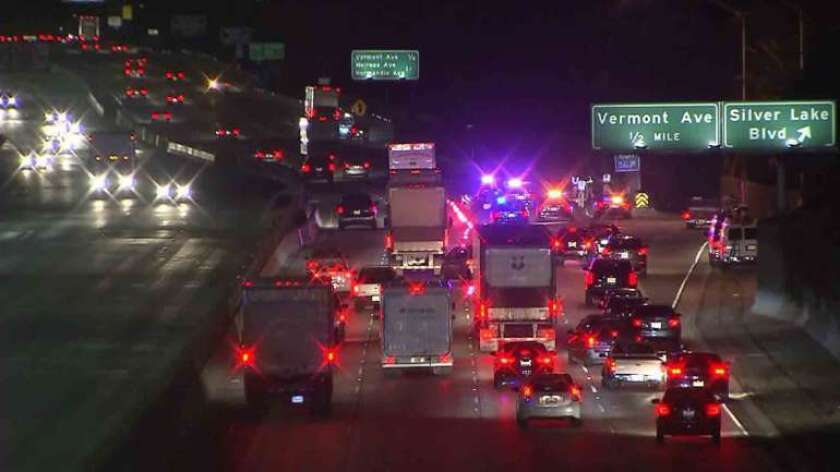 Two lanes of the northbound 101 Freeway were closed early Thursday at Silver Lake Boulevard after a body was discovered near the offramp.