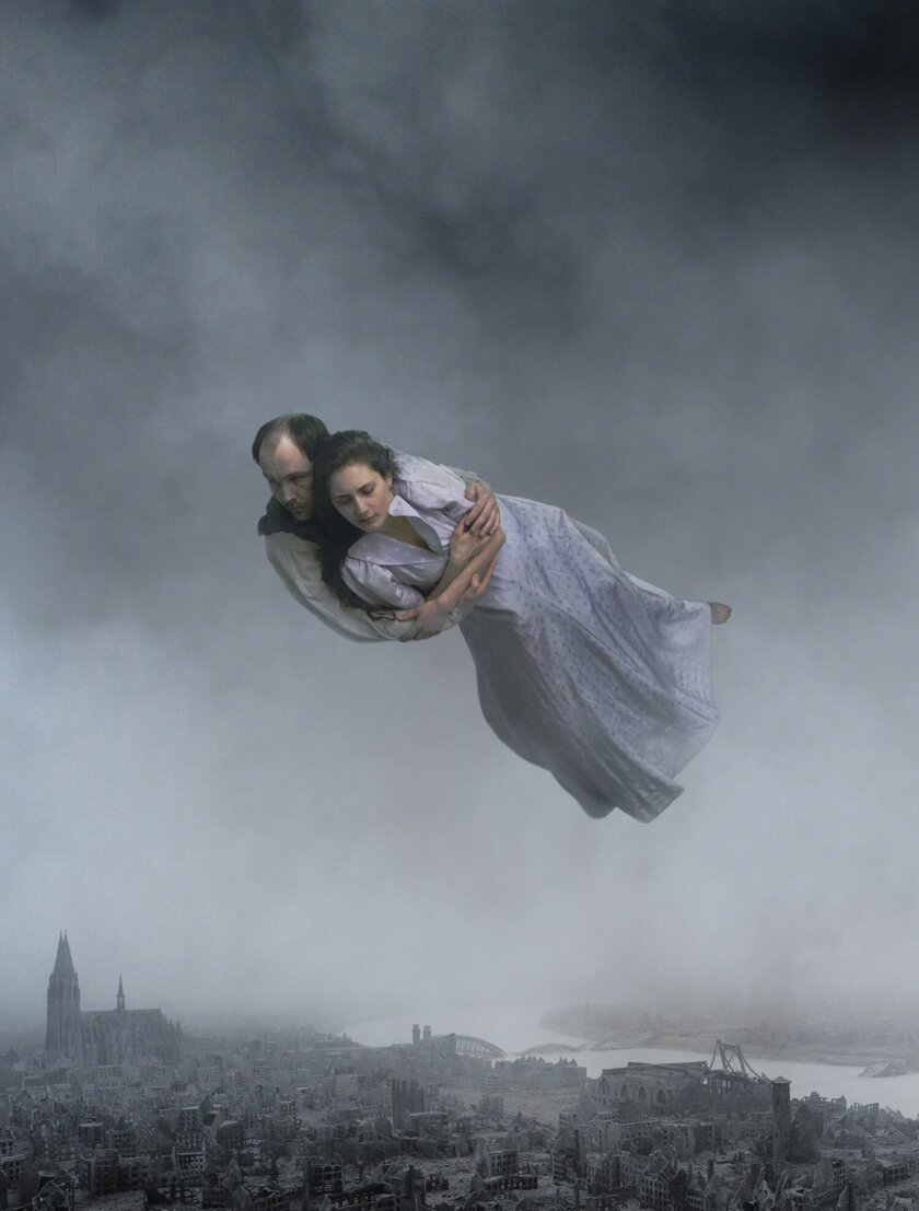 """A couples flies through the air in the movie """"About Endlessness."""""""