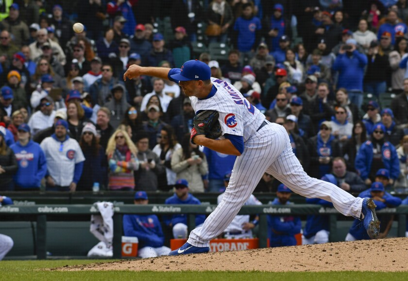 FILE - In this April 12, 2019, file photo, Chicago Cubs relief pitcher Brandon Kintzler delivers during the ninth inning of a baseball game against the Los Angeles Angels in Chicago. Kinztler and the Miami Marlins have finalized a one-year contract that guarantees $3,275,000. (AP Photo/Matt Marton, File)