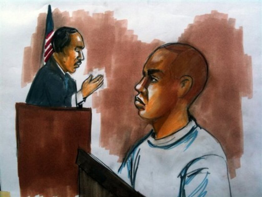 This courtroom drawing shows Umar Farouk Abdulmutallab, 23, right, charged with attempting to blow up a Detroit-bound U.S. airliner, at his hearing in Detroit federal court on Friday Jan. 8, 2010. Abdulmutallab was arraigned Friday on six charges. The most severe carries up to life in prison, the attempted use of a weapon of mass destruction. (AP Photo/Verna Sadock)