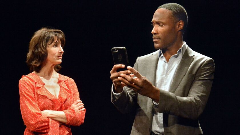 "Melissa R. Randel, co-chair of theater arts at Glendale Community College, and Daryl C. Brown in a scene from ""Confederates,"" playing in rotation with ""Exit Wounds"" at the Grove Theater Center in Burbank."