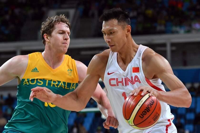 China's Yi Jianlian, right, works around Australia's forward Cameron Bairstow at the Olympics on Tuesday.