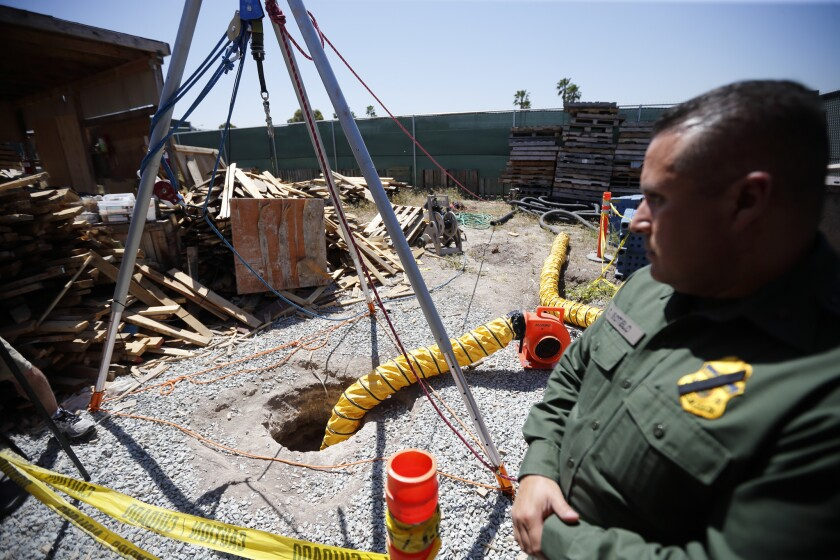 Border Patrol Special Operations Supervisor Cesar Sotelo looks toward the entrance of a recently discovered tunnel leading from Mexico to San Diego.