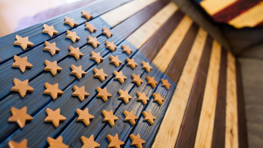 Brett Siciliano says he gives his wooden flags a worn look because it gives them character.