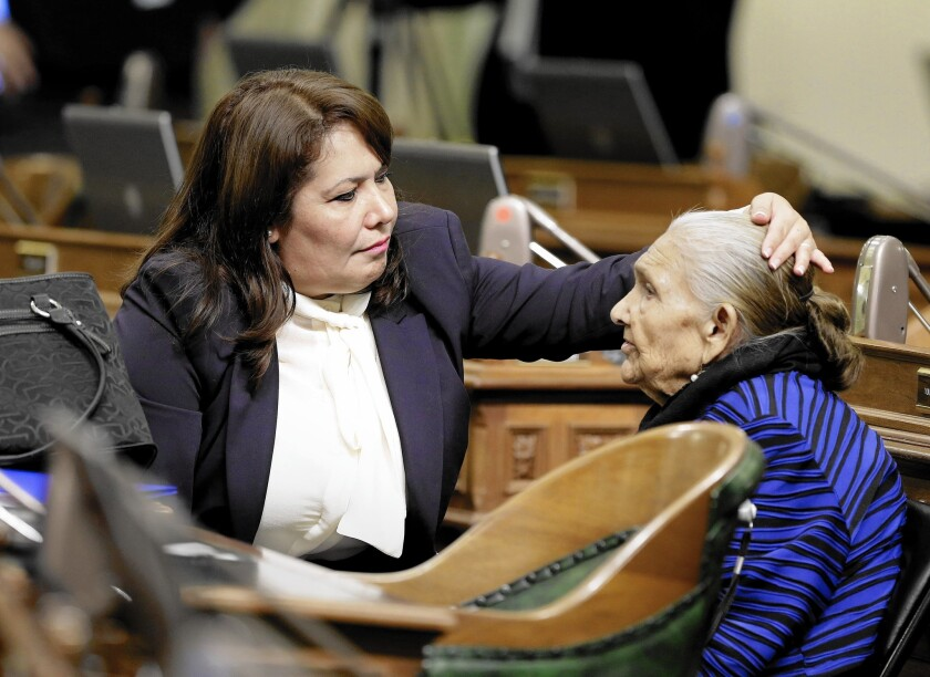 Freshman Assemblywoman Patty Lopez (D-Arleta), left, helps her mother, Maria de Jesus, with her hair before the start of the Assembly session in December. Detractors are pressuring Lopez to resign.