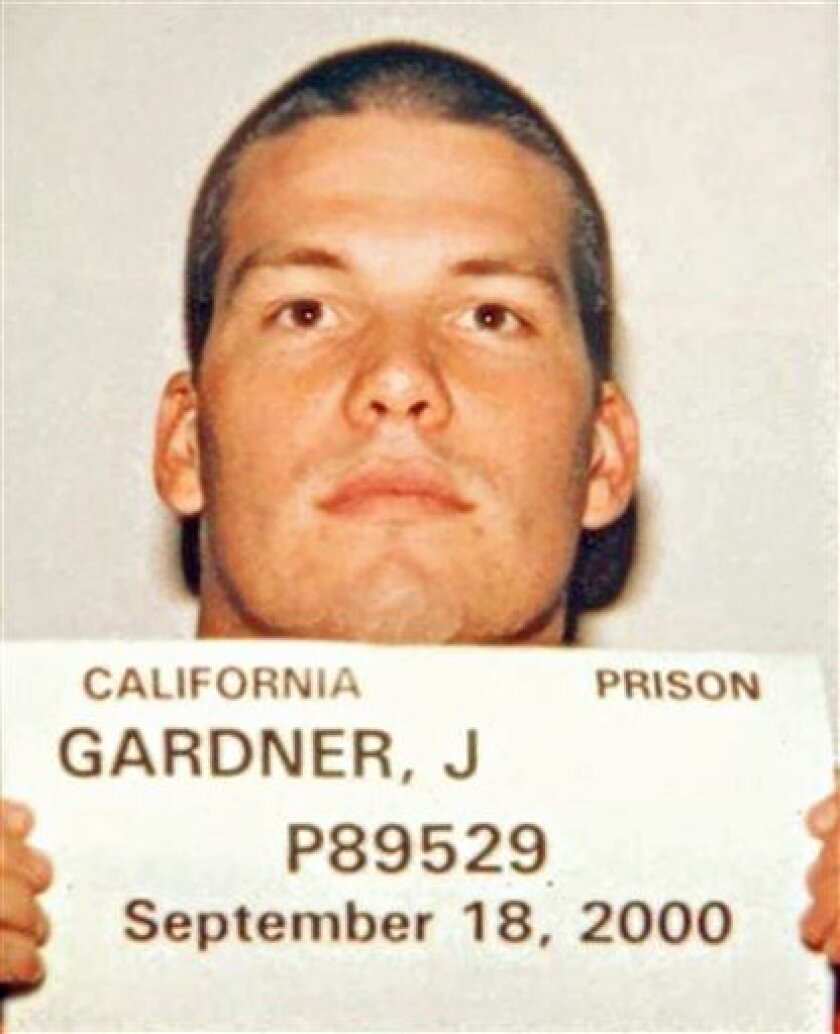 This photo released Wednesday, March 10, 2010, by the California Department of Corrections and Rehabilitation, shows murder suspect John Albert Gardner III holding a prison identification card taken Sept. 18, 2000, when he was serving time after pleading  guilty to committing lewd and lascivious ac