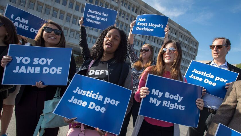Activists demonstrate Friday outside the Department of Health and Human Services in Washington in support of a pregnant 17-year-old immigrant being held in a federal detention facility in Texas who is seeking an abortion.