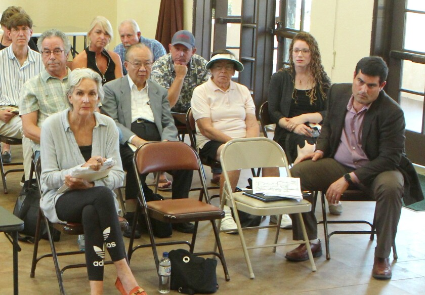 Melinda Merryweather (front left) makes her case for removing the red curbs along the east side of La Jolla Farms Road while surrounded by some opponents at the Sept. 18 meeting at the Rec Center.