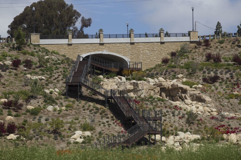 A long metal stairway leads to the Civita Falls Overlook.