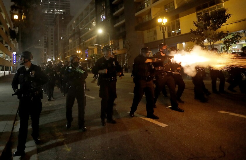 Police fire percussion rounds to clear protesters from Grand Avenue in in downtown Los Angeles in May