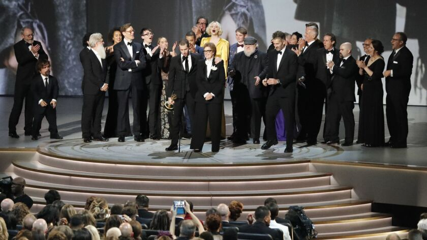 "Producers, cast and crew of HBO's ""Game of Thrones"" collected the Emmy for outstanding drama series Monday night at the 70th Primetime Emmy Awards at the Microsoft Theater in Los Angeles."