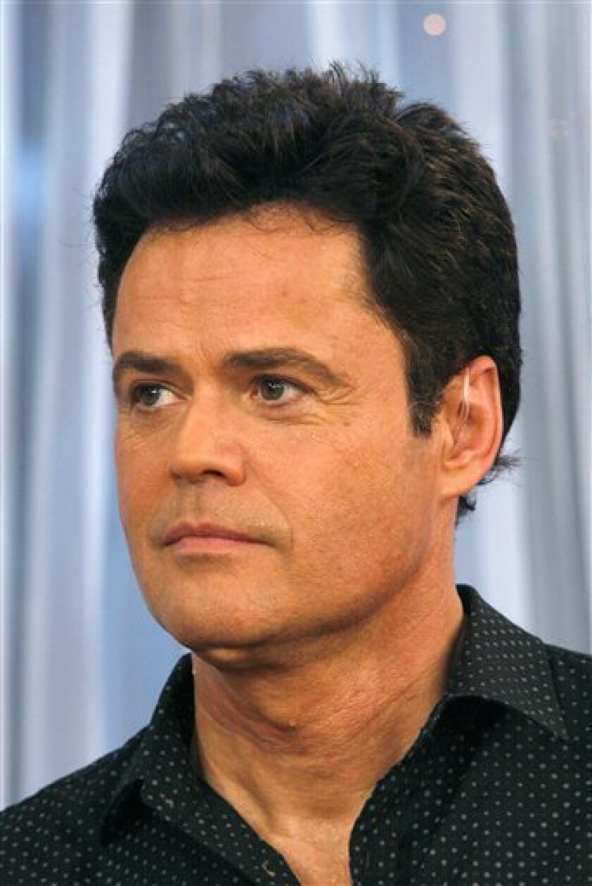 """FILE - 'Dancing with the Stars' champion Donny Osmond appears on ABC's 'Good Morning America' on in this Nov. 25, 2009 file photo taken in New York. Osmond is coming back to the airwaves as he launches a radio show on the heels of his """"Dancing With the Stars"""" win. A music show hosted by the 52-year-old Las Vegas headliner debuts Jan. 18, 2010 on about 60 stations across the country. (AP Photo/Andy Kropa, File)"""