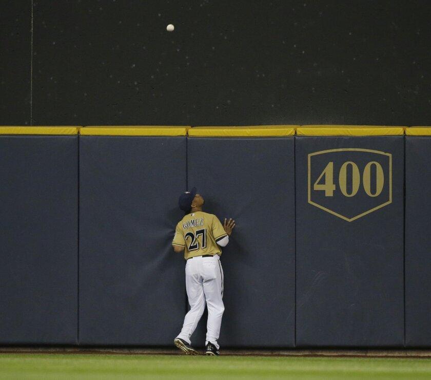 Milwaukee Brewers' Carlos Gomez watches a three-run home run by Arizona Diamondbacks' Paul Goldschmidt during the fourth inning of a baseball game Saturday, May 30, 2015, in Milwaukee. (AP Photo/Jeffrey Phelps)