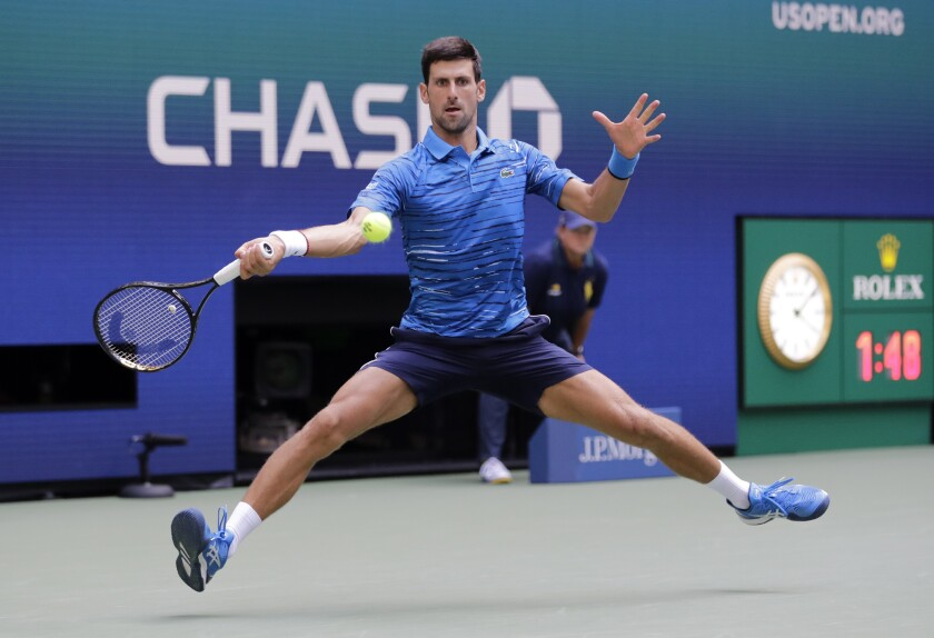 Novak Djokovic returns a shot during his first-round victory over Roberto Carballes Baena at the U.S. Open on Monday.