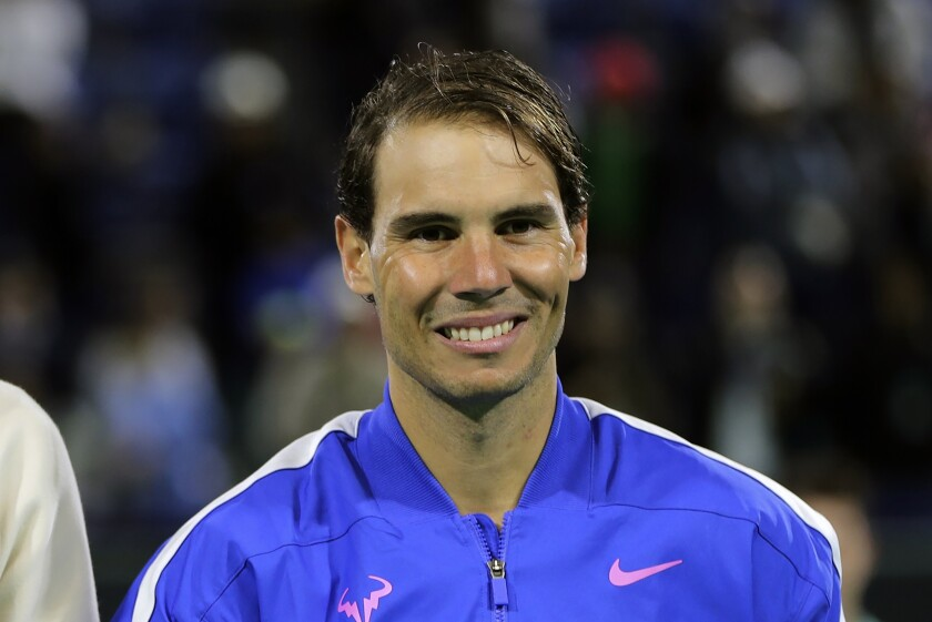FILE - In this Saturday, Dec. 21, 2019, file photo, Rafael Nadal from Spain smiles after defeating Stefanos Tsitsipas of Greece at the Mubadala World Tennis Championship in Abu Dhabi, United Arab Emirates. Nadal is ranked No. 2 heading into the French Open. (AP Photo/Kamran Jebreili, File)