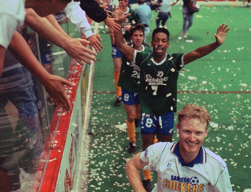 Paul Dougherty leads a parade of San Diego Sockers, some wearing the losing team's jersey as part of a tradition, in a victory lap around the Sports Arena. The Sockers won their fifth consecutive Major Soccer League championship with an 8-2 victory over Dallas in Game 6.