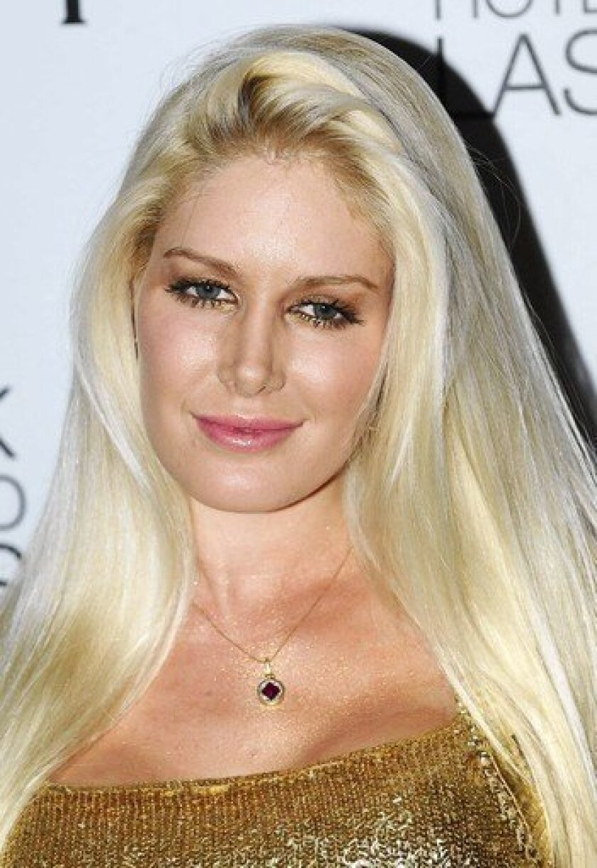 """Reality television personality Heidi Montag had 10 plastic surgeries in one day at age 23. """"If I could take it back, I would,"""" she told ABC News."""