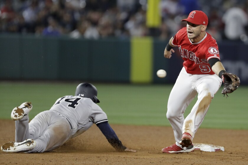 New York Yankees' Tyler Wade, left, steals second past Los Angeles Angels second baseman Tommy La St