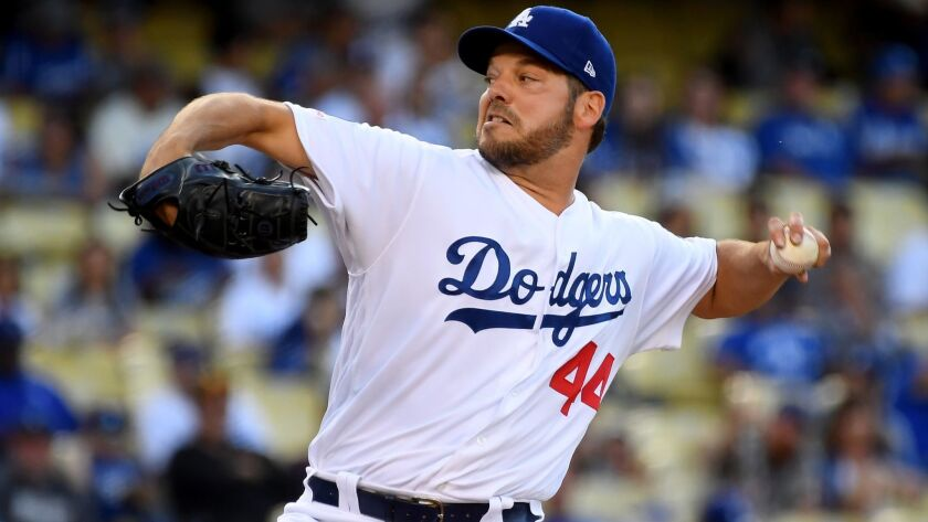 Dodgers pitcher Rich Hill pitches in the first inning against the San Francisco Giants at Dodger Stadium on Wednesday.
