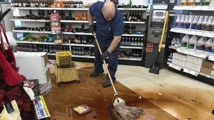 Randy Van Ness mops an aisle at Andy's Ace Hardware after a 7.0-magnitude earthquake hit in Anchorag