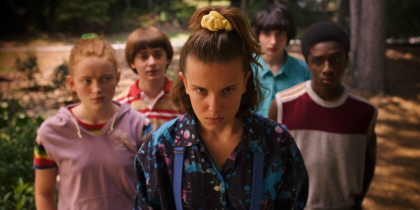 "Sadie Sink (left) Noah Schnapp, Millie Bobby Brown, Finn Wolfhard and Caleb McLaughlin in a scene from the third season of Netflix's ""Stranger Things."" All eight episodes of this new season were available on July 4."